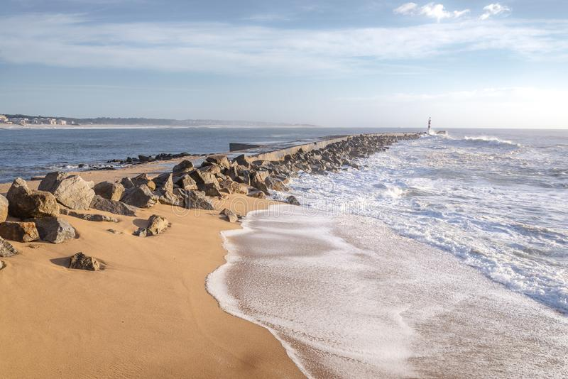 The lighthouse bay of the town of Vila do Conde. Seascape photography soft sunlight and colors in the bay of Vila do Conde in north Portugal royalty free stock photos