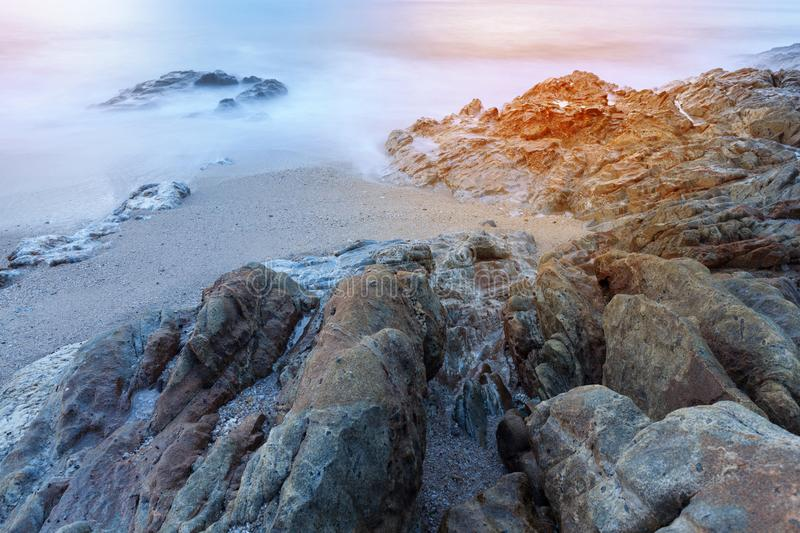Seascape of rock in long exposure,composition of nature for back stock photo