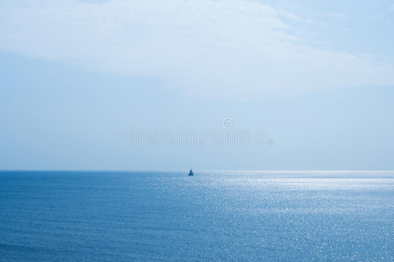 Seascape and a sailing boat. A beautiful seascape and a sailing boat in the middle of the image stock photography