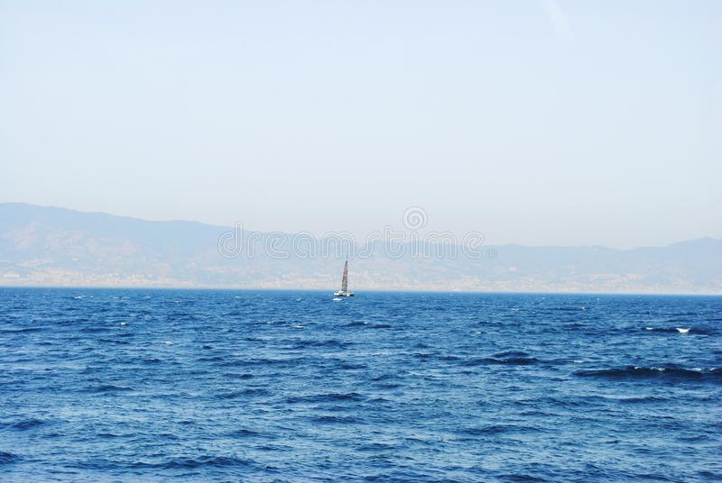 Seascape. Sailing vessel. View of Sicily, Italy stock images
