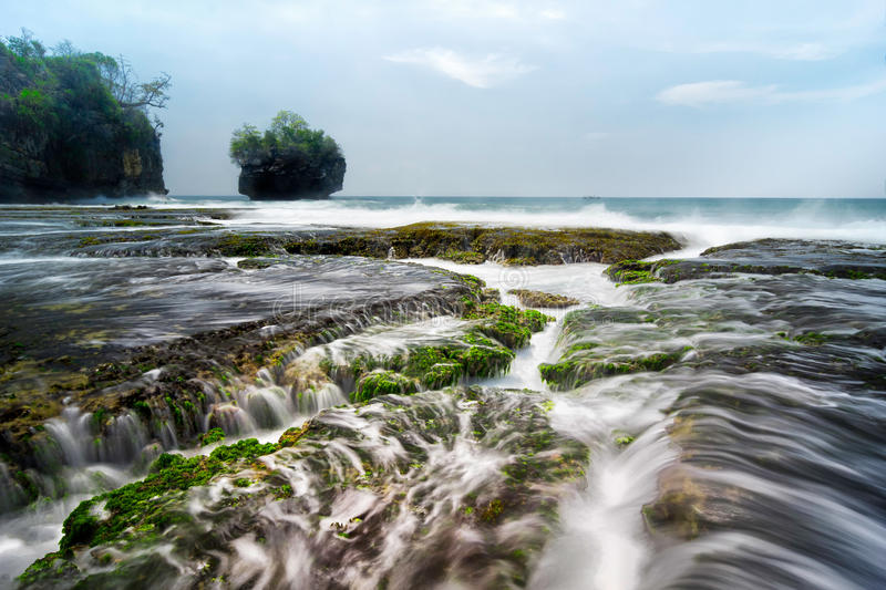 Seascape scenery of beautiful coral at Sawarna,Banten,Indonesia. Seascape scenery of beautiful coral formation with sea water flow during mid day at Sawarna stock photo