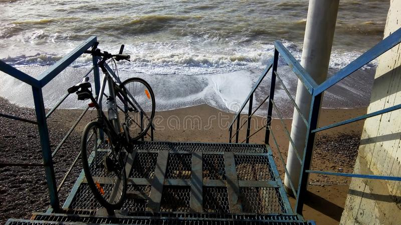 Bicycle on stairs by the sea royalty free stock photography