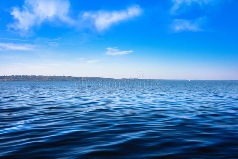 Seascape with sea horizon and almost clear deep blue sky - Background. water stock photo