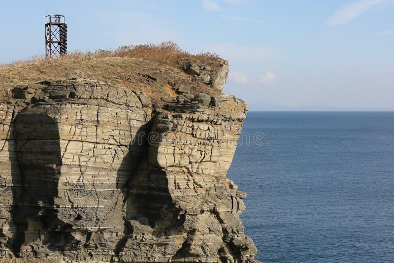 Seascape of the Sea of Japan: transparent blue water, rocky coast in sunny autumn day. Russky island, Tobizina Cape, Vladivostok,. Russia royalty free stock image