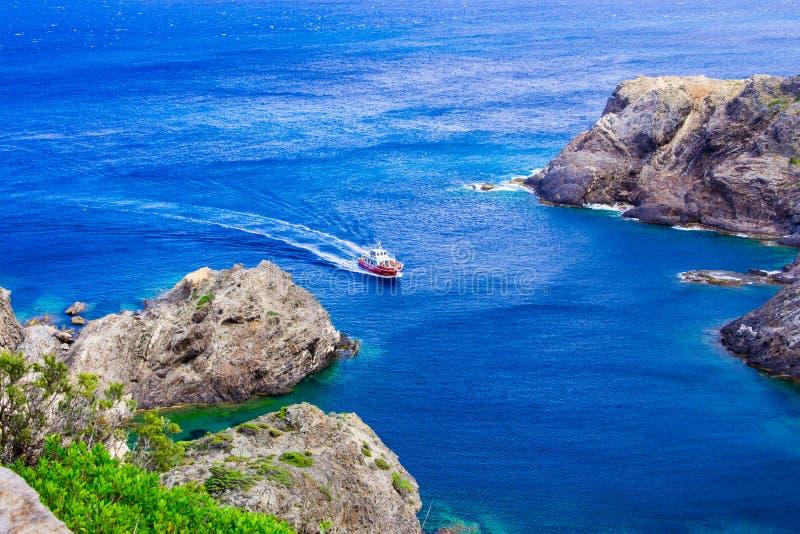 Seascape and ship in Cap de Creus, cape in Cadaques, Girona, Costa Brava, Catalonia, Spain. Mediterranean sea coast of Spain. stock photography