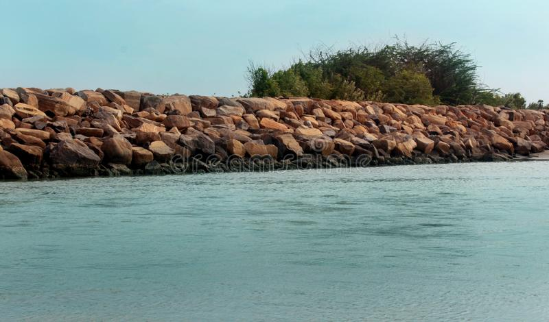 A seascape of the shrine velankanni beach with stone fence. royalty free stock photography
