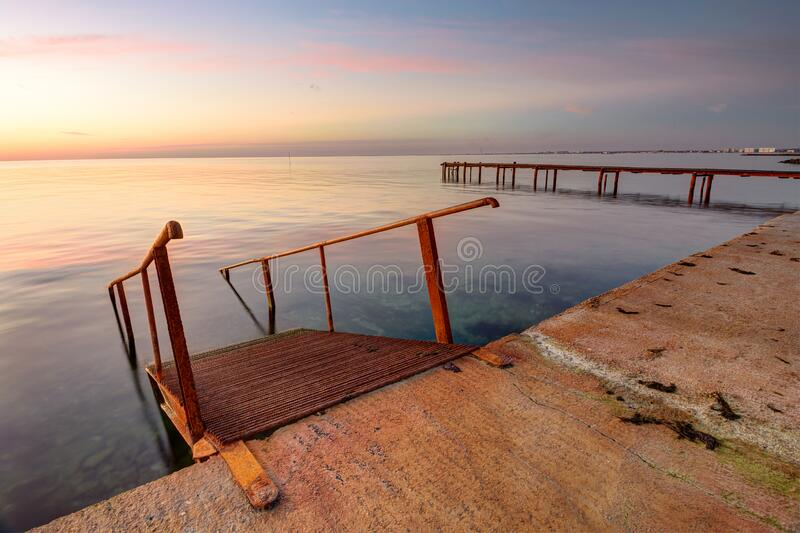 Seascape, staircase descends into the sea, on the far side of the pier. Seascape, staircase descends into the sea, on the far side of the  pier royalty free stock image