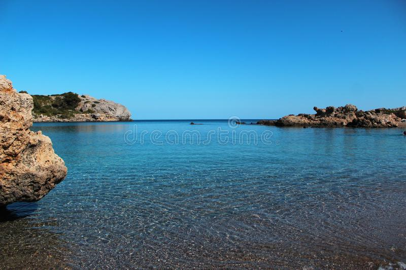 Seascape - summer holiday concept perfect for commercials. Perfect summer holidays concept, crystal clear sea, sea rocks, blue sky royalty free stock photos