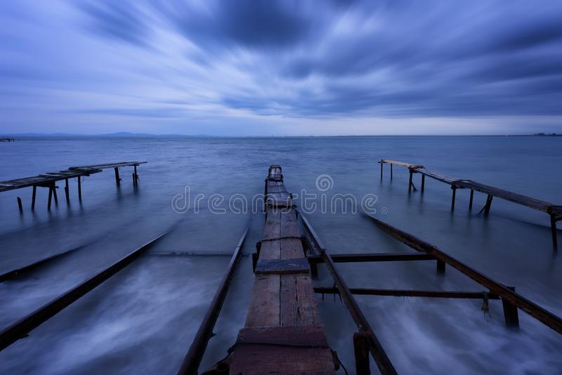 Seascape during sunset. Beautiful natural seascape, blue hour. Sea sunset at the Black Sea coast. Magnificent sunset with clouds in the middle of December stock image