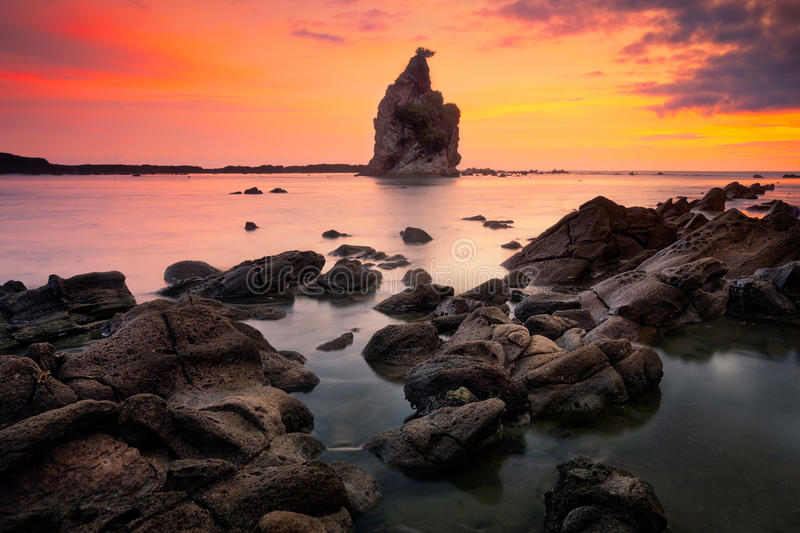 Seascape sunset scenery at Tanjung Layar beach,Sawarna, Banten, Indonesia. Beautiful seascape scenery of big boulder stone with small rock foreground during stock images