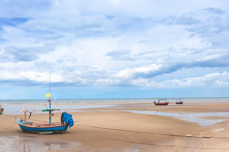 Seascape in Thailand with fishing boats on low tide beach. royalty free stock images