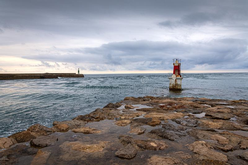 Seascape with two lighthouses, a cloudy afternoon. On the coast of Cantabria, Spain royalty free stock photo