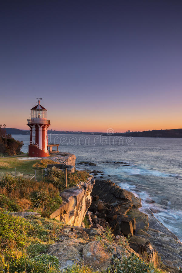 Seascape view with red and white lighthouse stock photos