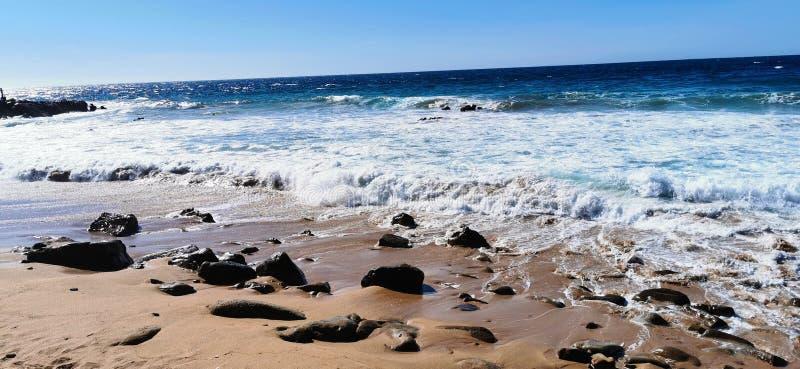 Seascape of waves crashing on the rocks stock photo