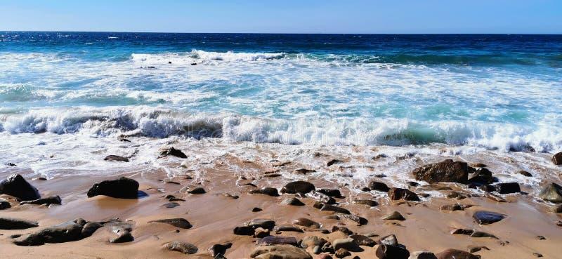 Seascape of waves crashing on the rocks stock photography