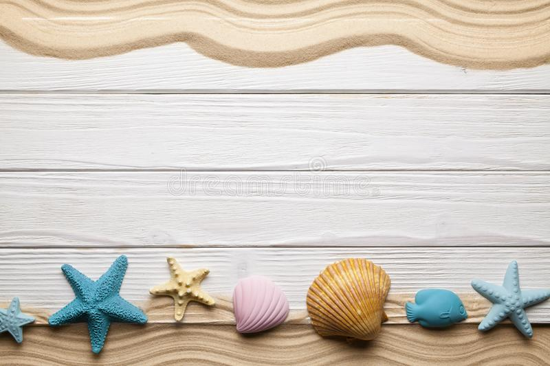 Seashells, beach sand and wooden planks stock photos