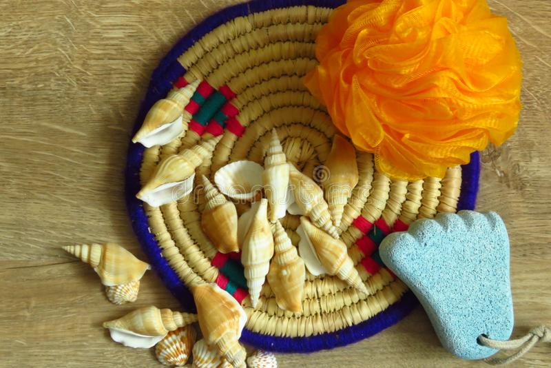 Body care. Different Seashells, Foot Shaped Pumice, Sponge and Bamboo Tray. stock photo