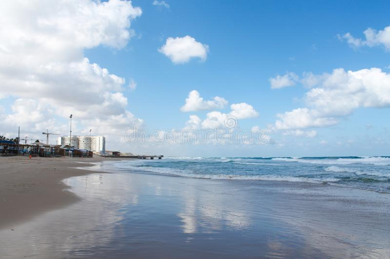 Seashore at Bat Yam, Israel. Blue Mediterranean coastline with reflection of sky and clouds. Travelling picture royalty free stock photos