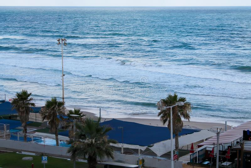 Seashore at Bat Yam, Israel. Waves on the blue stormy sea. Mediterranean coastline. Travelling picture stock image