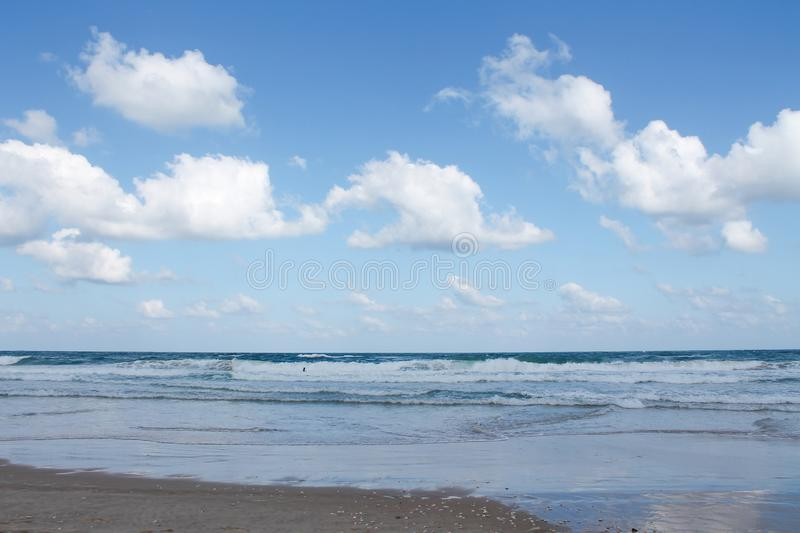 Seashore at Bat Yam, Israel. Waves on the blue stormy sea. Mediterranean coastline. Travelling picture royalty free stock photos