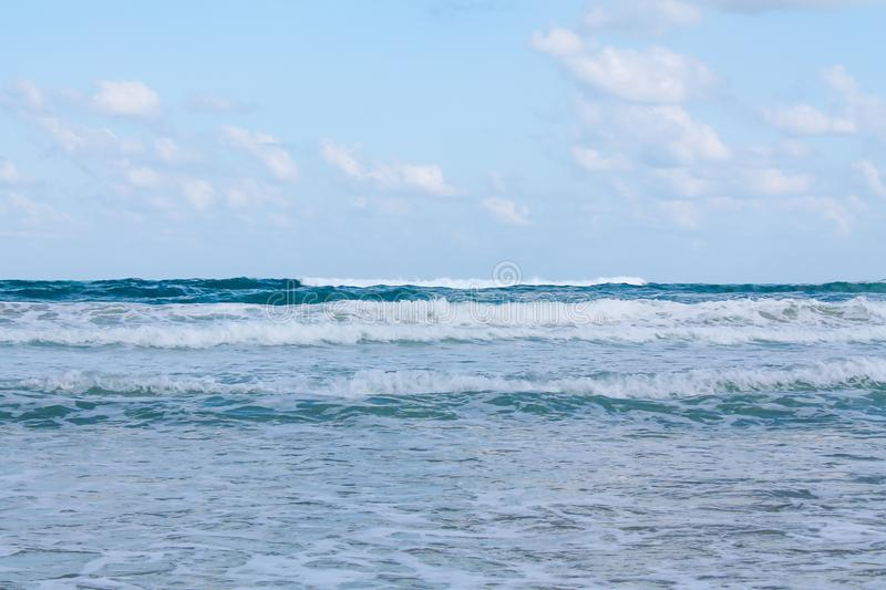 Seashore at Bat Yam, Israel. Waves on the blue stormy sea. Mediterranean coastline. Travelling picture. Turquoise water and sandy beach stock photo