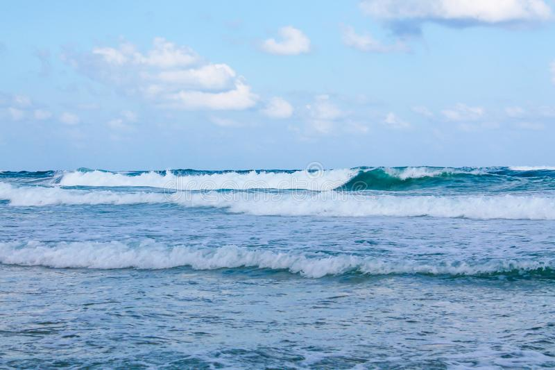Seashore at Bat Yam, Israel. Waves on the blue stormy sea. Mediterranean coastline. Travelling picture. Turquoise water and sandy beach royalty free stock image