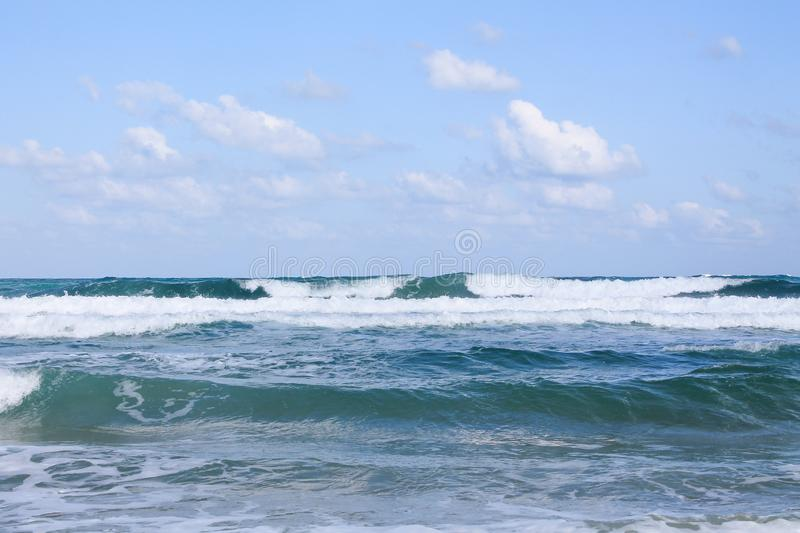 Seashore at Bat Yam, Israel. Waves on the blue stormy sea. Mediterranean coastline. Travelling picture. Turquoise water and sandy beach stock photos