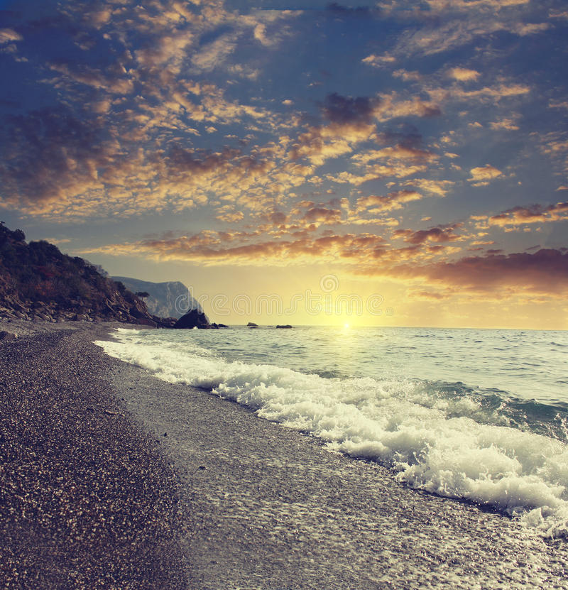 Seashore ( Beach ) With The Waves At Sunset Stock Photo