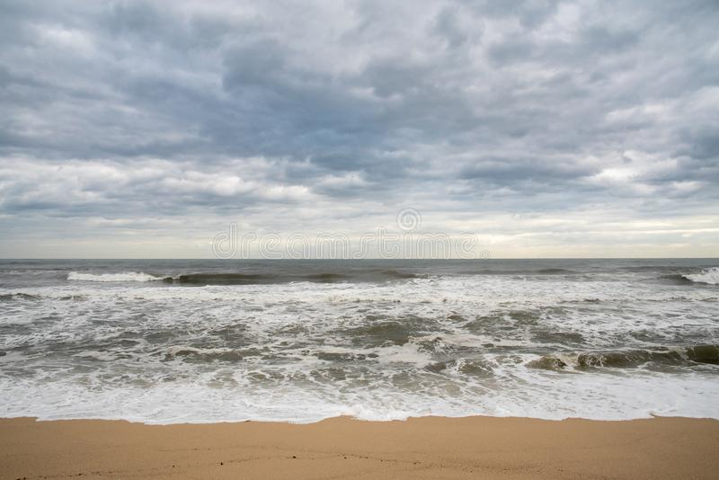 A seashore scene in which high waves come with cloudy weather and strong winds. South Korea Donghae the sea stock images