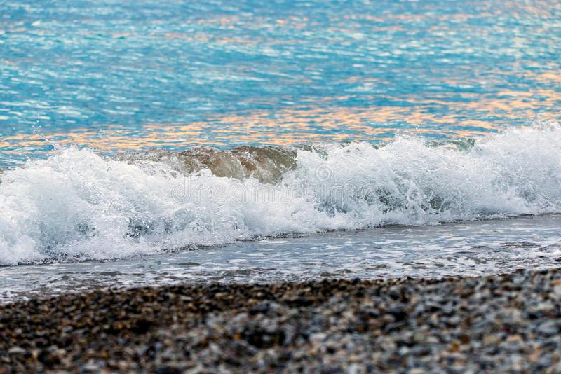 Seashore on stone beach. Close up view. Closeup, nature, ocean, water, wave, background, coast, wet, blue, splash, natural, outdoor, summer, texture, travel royalty free stock photo