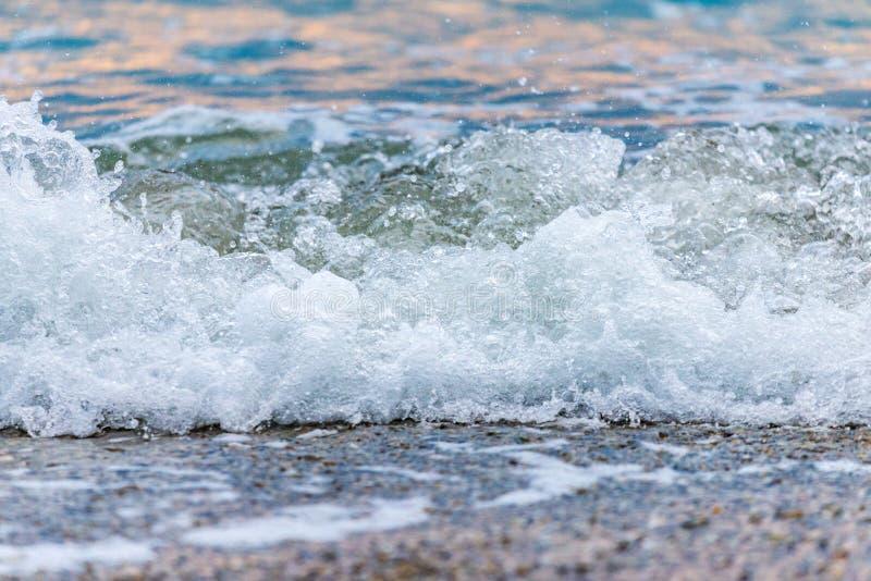 Seashore on stone beach. Close up view royalty free stock photo