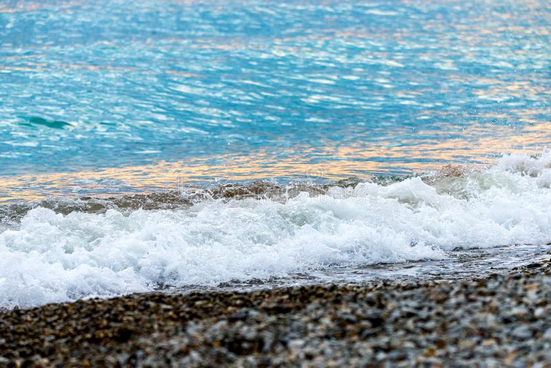 Seashore on stone beach. Close up view. Closeup, nature, ocean, water, wave, background, coast, wet, blue, splash, natural, outdoor, summer, texture, travel royalty free stock photos