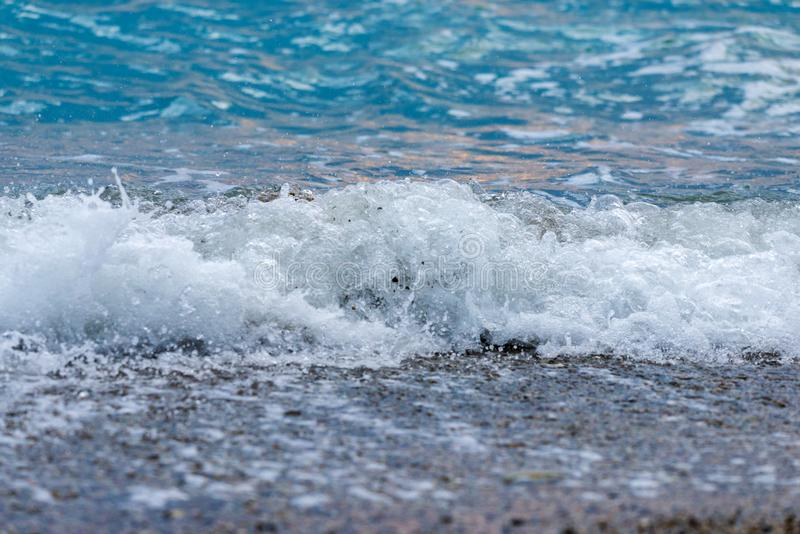 Seashore on stone beach. Close up view royalty free stock images