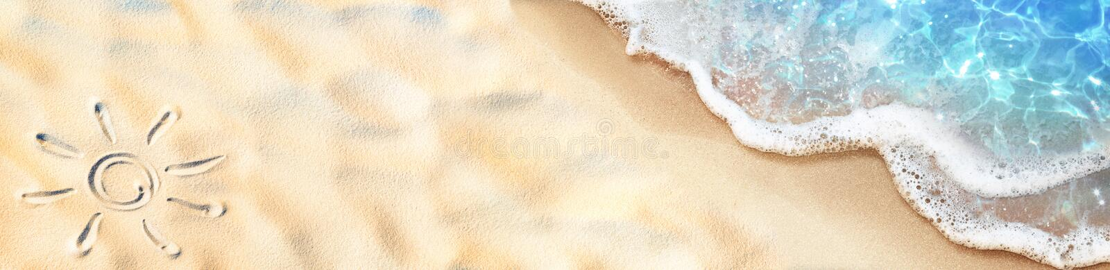 Seashore - Sun Drawn On The Sand And Waves stock photo