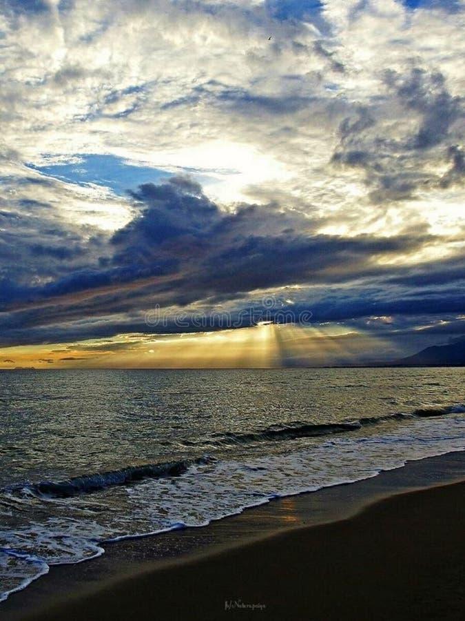 Seashore at sunset stock photos