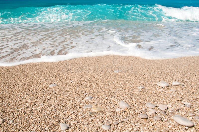 Seashore, waves and sandy beach royalty free stock photography