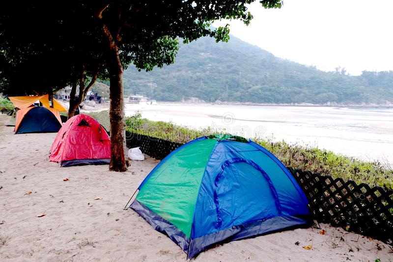 Seaside beach camping. Seaside beach is the land along the water or the flat land above the water surface formed by sand deposition. It is a good place for stock photography