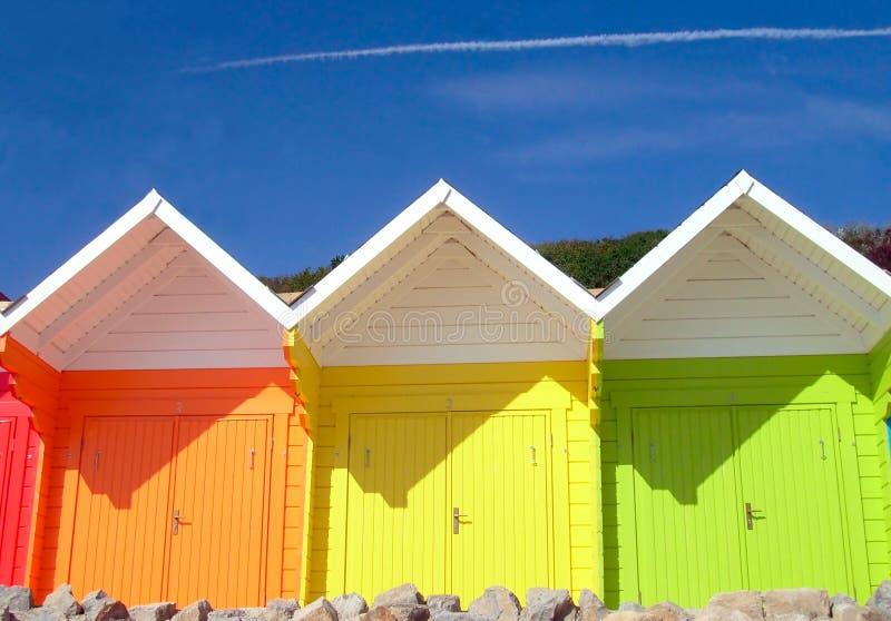 Seaside beach chalets. Three seaside beach chalets, Scarborough, England stock photos
