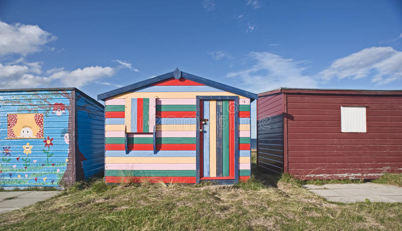 Seaside beach hut. An image of a seaside beach hut decorated in rainbow colors seen at Hopeman on the north East Scottish Coast royalty free stock photos