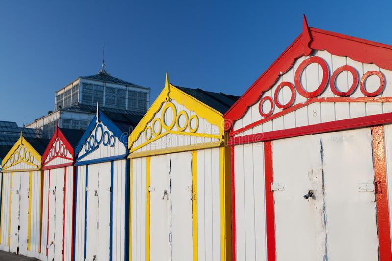 British seaside holiday resort beach huts in a row. stock photos