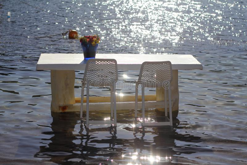 Seaside blue table and chairs open cafe outdoor restaurant in Turkey on sea shore. Summer vacation on resort. royalty free stock images