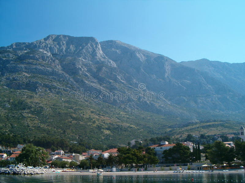 Seaside in Croatia. Photo of a seaside in Croatia surrounded by mountains royalty free stock image