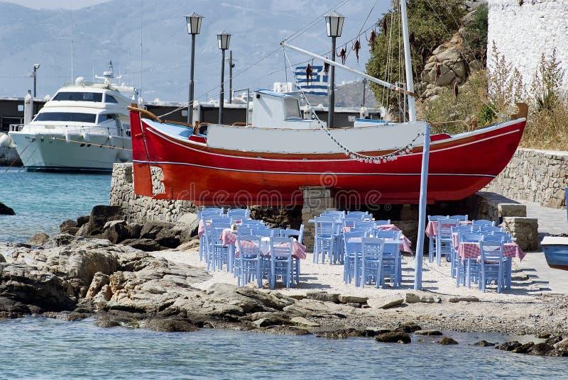 Seaside dining, beach bar restaurant in Mykonos stock photos