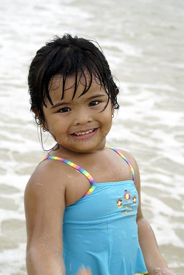 Seaside girl smiling sweetly stock images