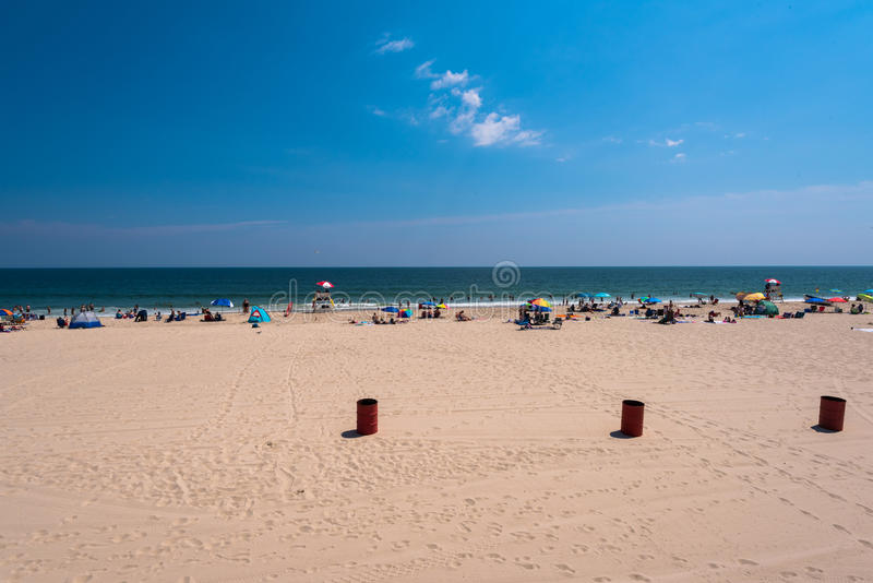 Seaside Heights Beach. Sunbathers relax on a bright sunny day on the Seaside beach at the Jersey Shore stock images
