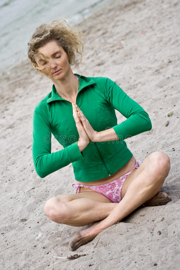 Download Seaside Meditation stock image. Image of blond, person - 10572603