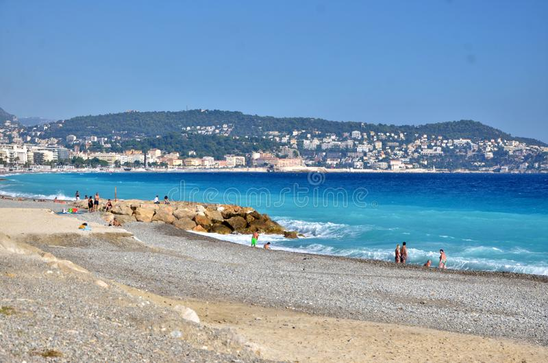 Seaside in Nice, Italy. Beach. With view of mountains stock image