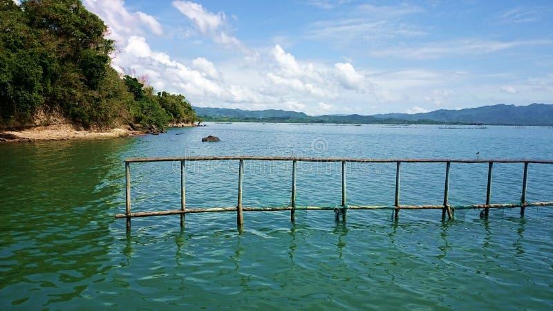 Seaside ocean shore bamboo nets for fish royalty free stock photo