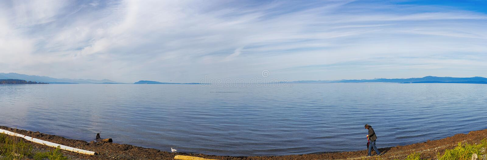 Panoramic view of qualicum beach in vancouver island, BC, canada. Seaside panoramic view at qualicum beach in vancouver island, british columbia, canada stock image
