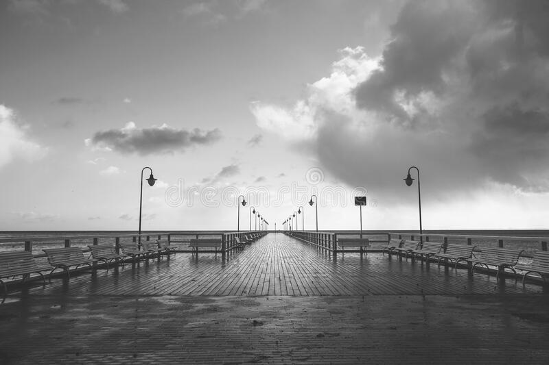 Seaside pier in black and white stock images